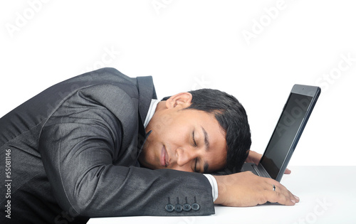 Indian Businessman Sleeping over the laptop