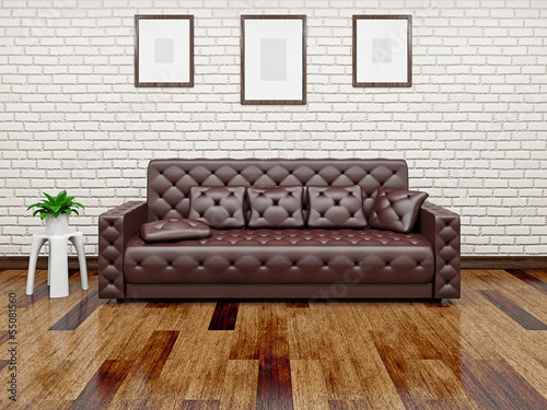Leather sofa near the wall