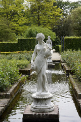 Statues and fountain in a formal garden