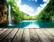 waterfall in deep forest of croatia and wood pier - 55082996