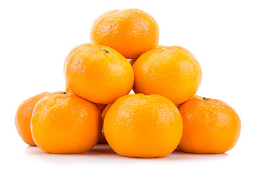 Heap of tangerines isolated on white background