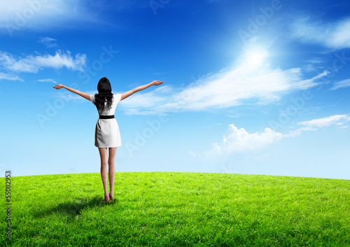 field of grass and happy young woman