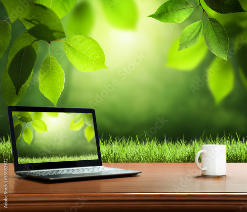 summer background with wooden table and notebook