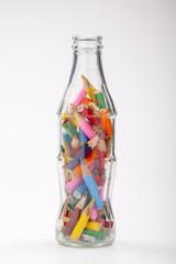 pencils colored into a transparent glass