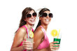 two girls fun with a drink, isolated on white background