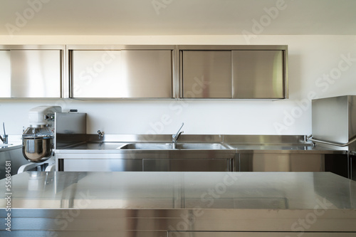 Leinwanddruck Bild Professional kitchen, view counter  in steel