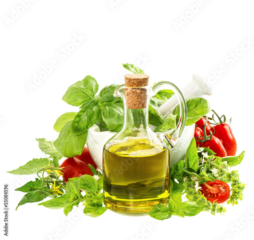 olive oil with fresh mediterranean herbs and tomatoes