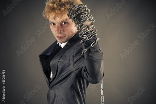 young businessman raises his arm up with a chain