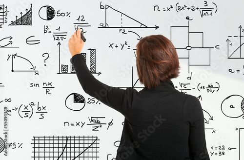 Woman writing formulas