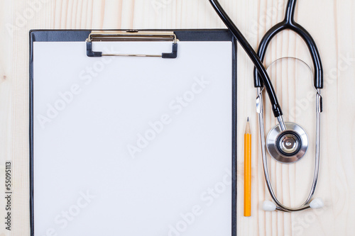 Doctor's stethoscope, clipboard with paper blank, pencil