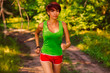 beautiful a healthy runs brunette young woman athlete running ou