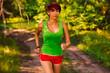 beautiful a healthy runs brunette young woman athlete running ou