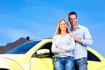 Couple near new car.