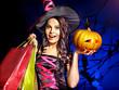 Woman holding Halloween shopping bag.