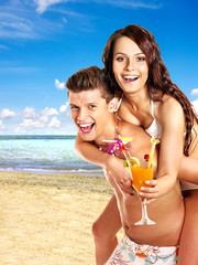 Couple with cocktail at  beach.