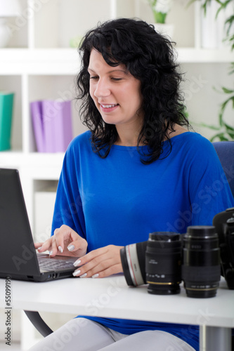 photographer woman professional using a notebook
