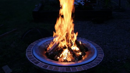 Wood Burning Fire Pit with Orange Flames at Night 1080p