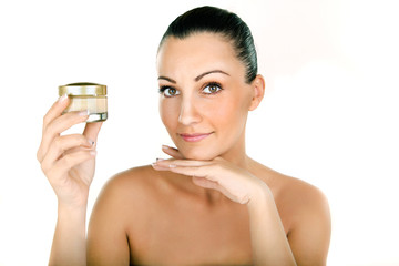 young woman holding cosmetic cream