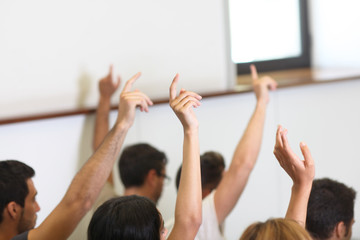 Students put hands up
