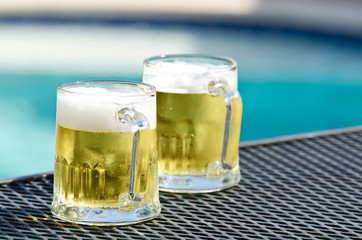 Cold beer glasses by pool