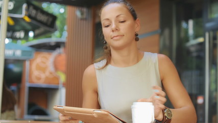 woman sits at a table at a fast food restaurant