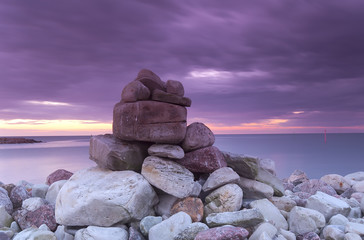 Piling of rocks, baltic ocean in the background