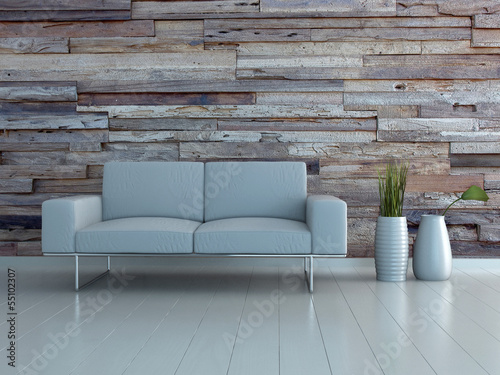 White couch and two vases standing in front of wooden wall