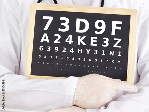 Ophthalmologist holding blackboard with eyesight test