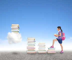 school girl learning knowledge from books to the cloud computing