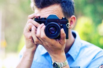 young photographer takes pictures