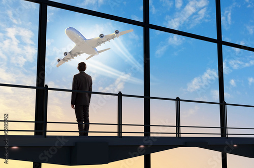 Businessman at airport - 55105982