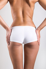 Woman with perfect body checking cellulite