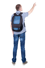 Back view of  pointing man with backpack looking up.