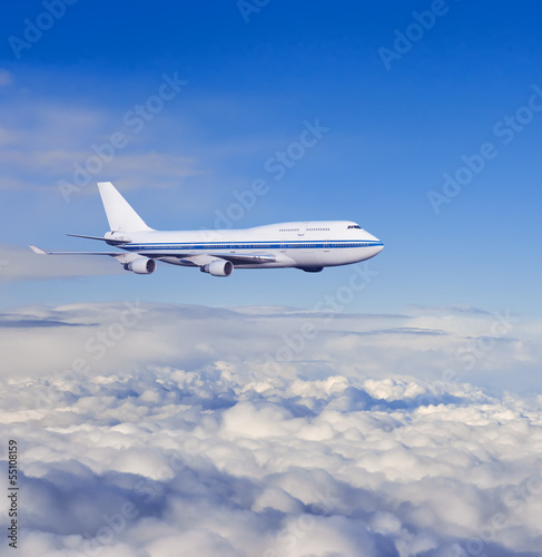 passenger airplane in the clouds.