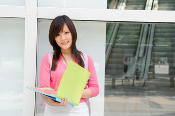 asian chinese college female student with campus background