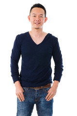 Handsome Asian male in casual standing over white background