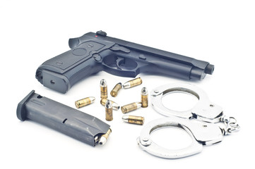 Pistol bullet magazine and handcuff isolated.