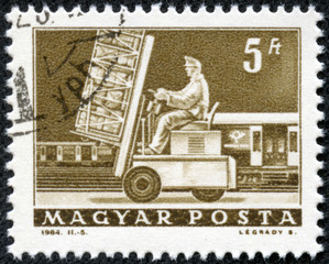 stamp printed in Hungary shows Post loading