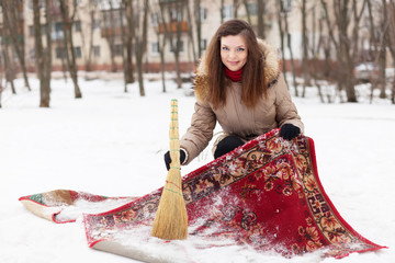 woman cleans carpet with snow