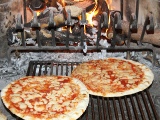 fragrant pizza baked in a wood fireplace with a wood-burning ove