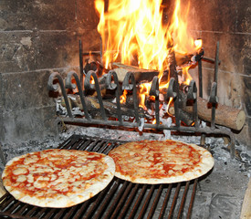excellent fragrant pizza baked in a wood fireplace with a wood-b