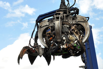 Scrap Motorbikes In Hydraulic Claw