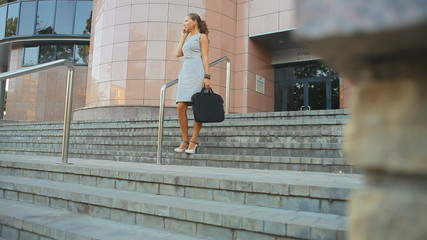 business woman standing near office building