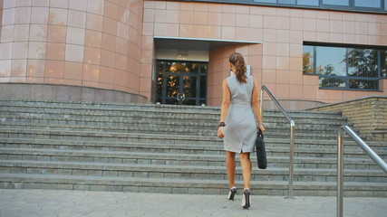 young business woman is sent to the office building