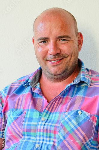 Middle aged bald man smiling