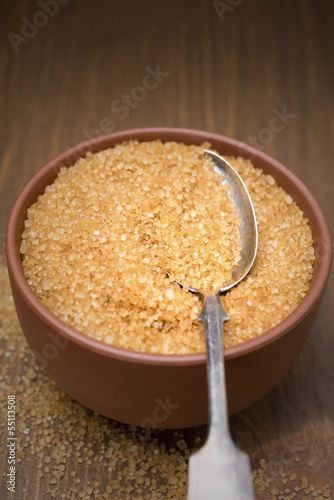brown sugar in a bowl and spoon, selective focus