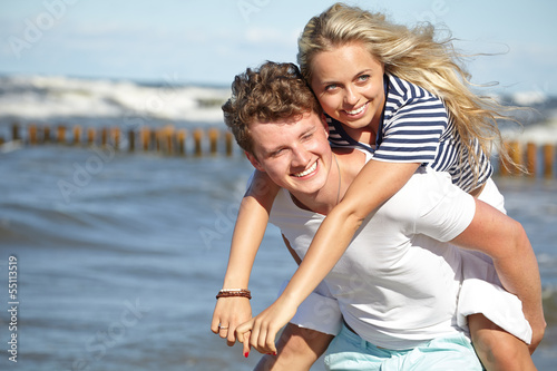 Young happy couple having fun on the beach.