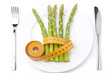 dietetic food - asparagus wrapped with measuring tape on plate