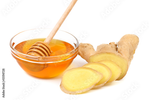Honey in bowl and a slices ginger root