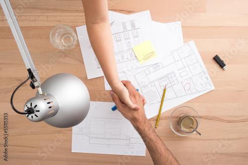 Handshake on a desk
